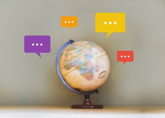 Spinning Globe With Speech Text Bubbles Around The Edge